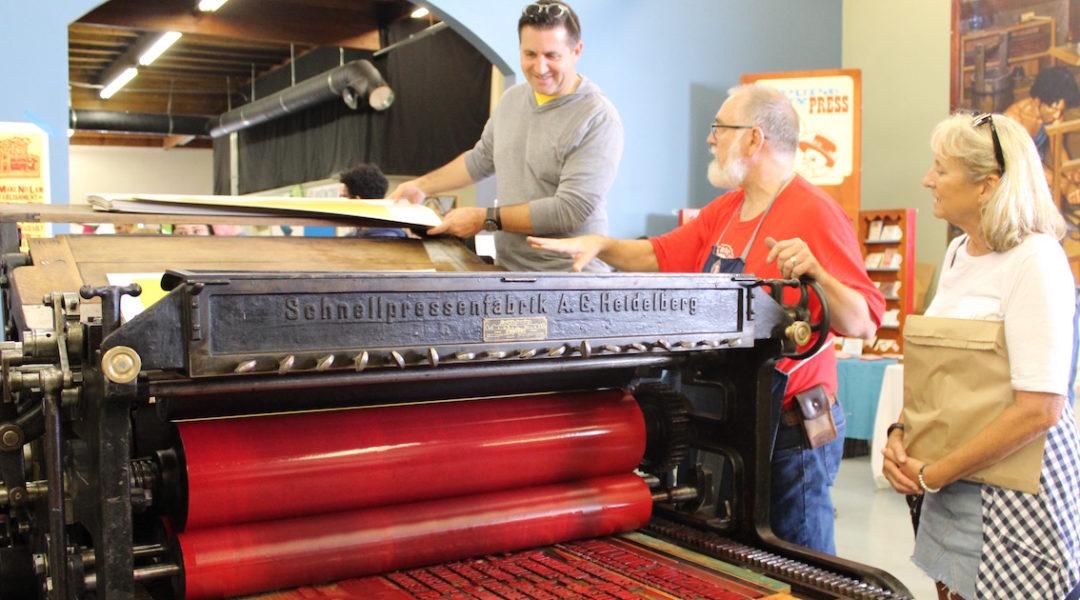 11 Printing on 1905 Cylinder Press copy - International Printing Museum